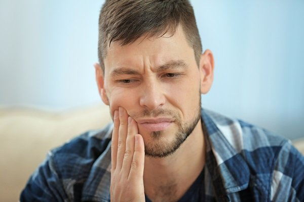 male with tooth sensitivity
