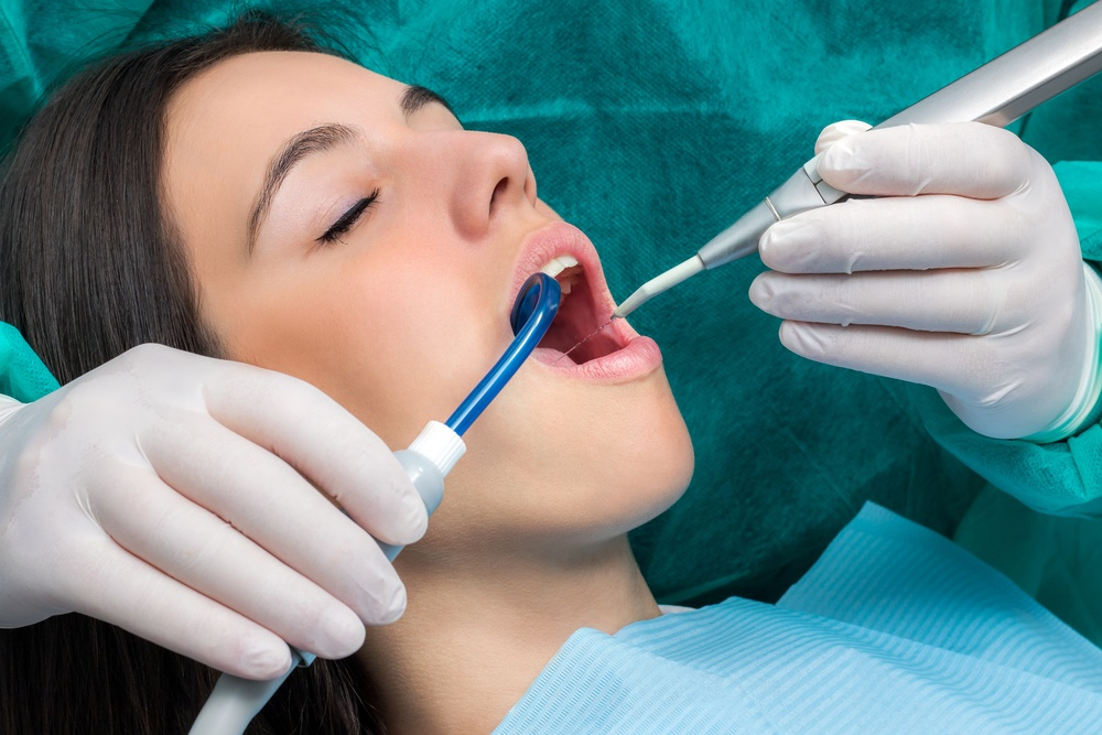 Woman having dental cleaning.
